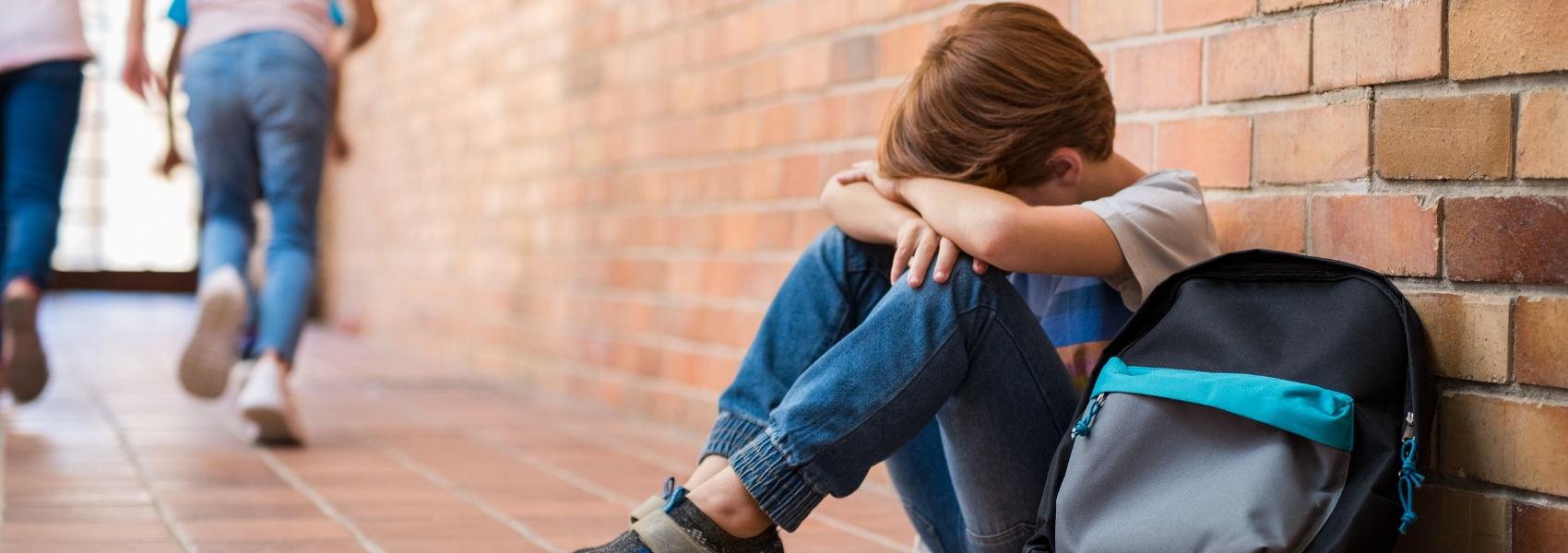 criança vítima de bullying